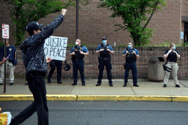 Protesters demonstrate in front of the Englewood Police Department during a Black Lives Matter rally condemning the killing of George Floyd at the hands of the Minneapolis police on Friday, June 5, 2020, in Englewood, N.J.