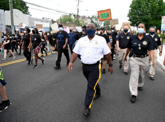 Bergen County Sheriff Anthony Cureton marches down Teaneck road during a Black Lives Matter protest condemning the killing of George Floyd at the hands of the Minneapolis police on Friday, June 5, 2020, in Teaneck.