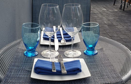 A table set for outdoor dining at Cafe Chameleon in Bloomingdale