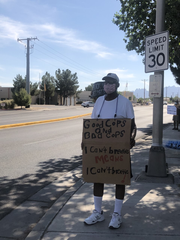 Russell Bell, a retired respiratory therapist, holds a sign in front of Alert Johnson Park Friday, June 5 to protest the treatment of George Floyd.