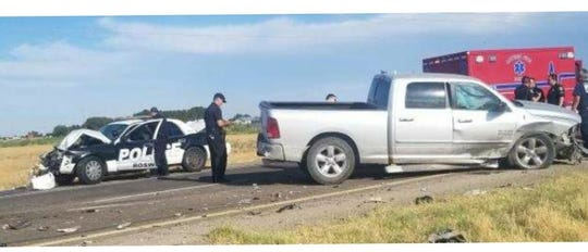Emergency personnel clean up a wreck near Artesia on June 4, 2020. Luiz Gauna of Roswell allegedly stole a Roswell police car and wrecked it, according to New Mexico State Police.