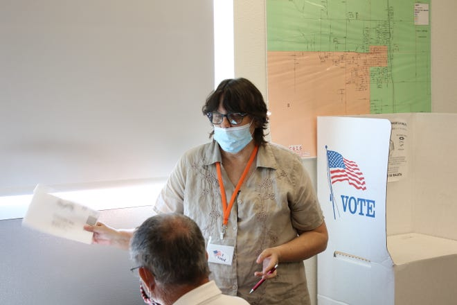 Wendy Bishop, presiding judge at the Eddy County Sub-Office in Artesia, goes over the ballot during the 2020 Primary Election on June 2, 2020. There were multiple contested races on the Republican side, including New Mexico Public Education Commission.