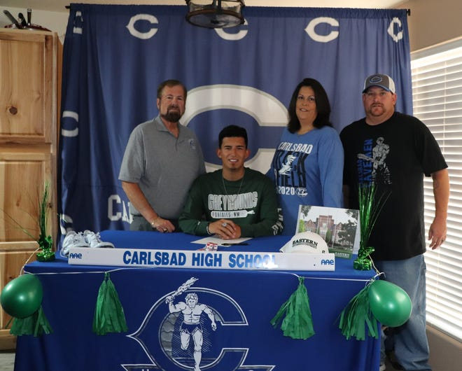 Carlsbad's Caleb Macias signs his letter of intent to attend Eastern New Mexico University on a track and field scholarship on May 31, 2020. Macias will become a decathlete for the Greyhounds track team.