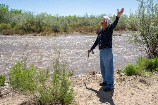 Gloria Emerson stands beside the San Juan River near her home in Shiprock.