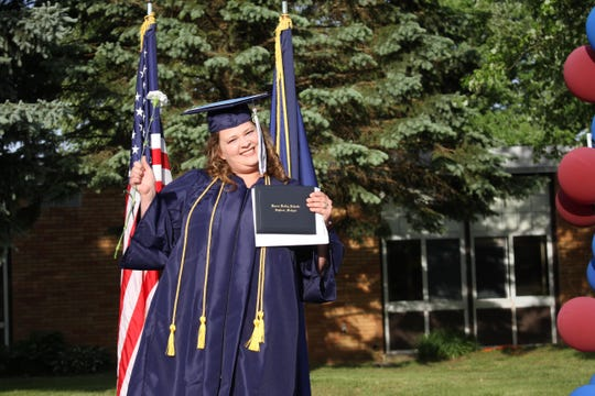 Jessica Worden celebrates her high school graduation during a commencement ceremony held by Huron Valley Schools on June 3, 2020.