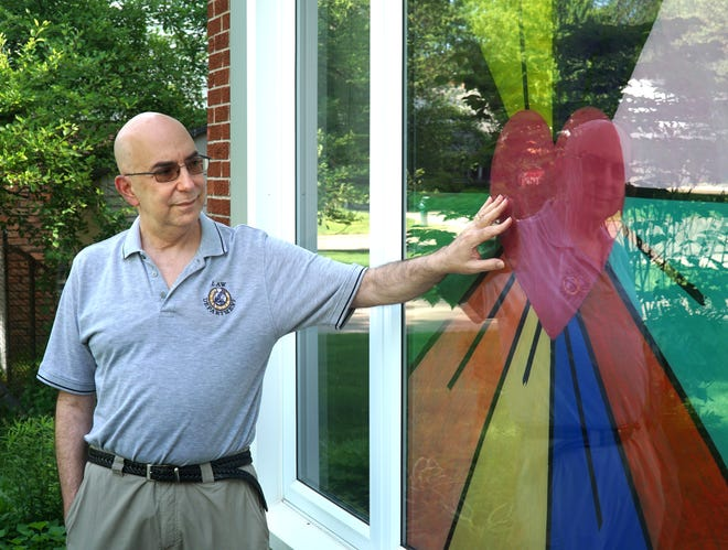 Eric Goldstein and his wife painted this colorful and hopeful sun and rainbow combination the window of their Southfield residence as Eric begins treatment for a glioblastoma brain tumor.