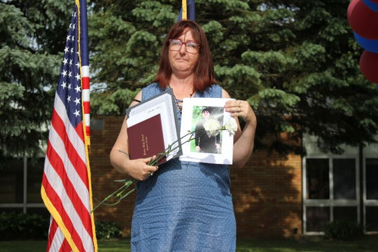 Christy Wagner of Milford accepted her son Joe Wagner's diploma during Harbor High's commencement on June 3, 2020. Joe Wagner was killed in an accident last September, a day after he completed his coursework.