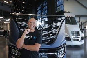 Nikola Motor's CEO, Mark Russell, stands in front of the Nikola Tre. The company makes fully electric and hydrogen fuel cell electric trucks.