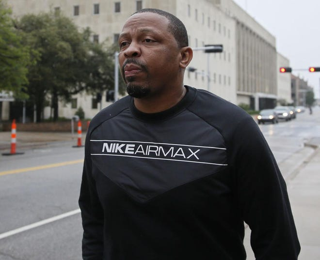 Lamont Evans, an assistant basketball coach at Oklahoma State University, leaves the federal courthouse following a court appearance in Oklahoma City, Wednesday, Sept. 27, 2017.