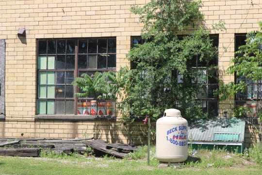 The property at 317 W. Perry St., well known by residents for its long-dilapidated beige-colored brick building, has been used by the city's service department for years.