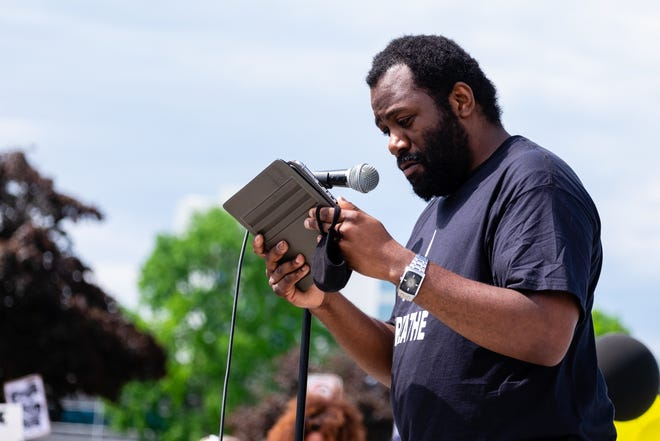 Alphonso Amos, chairperson for Black Lives Matter Port Huron, gets emotional while speaking in front of a crowd of demonstrators gathered in front of the Municipal Office Complex Friday, June 5, 2020, during a demonstration organized by Black Lives Matter Port Huron.