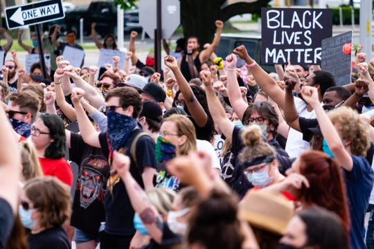 Demonstrators gather in front of the Municipal Office Complex Friday, June 5, 2020, during a demonstration organized by Black Lives Matter Port Huron. The march comes after more than a week of nationwide protests in response to the killing of George Floyd in Minneapolis.