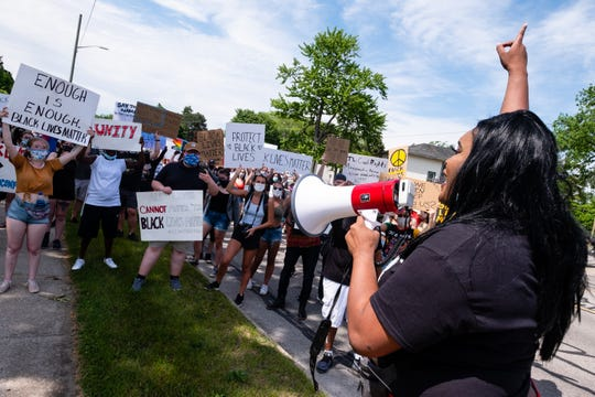 Kayshea Rivers, with Black Lives Matter Port Huron, right, addresses demonstrators as they march through downtown Port Huron Friday, June 5, 2020, in a march organized by Black Lives Matter Port Huron. The march comes after more than a week of nationwide protests in response to the killing of George Floyd in Minneapolis.