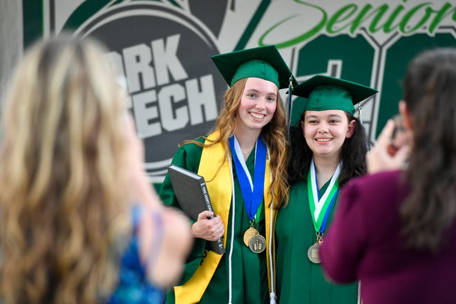 York Tech graduates Chloe Carroll, left, and Halee Shich pose for a photo during the last day of individual graduation ceremonies, Thursday, June 4, 2020. John A. Pavoncello photo