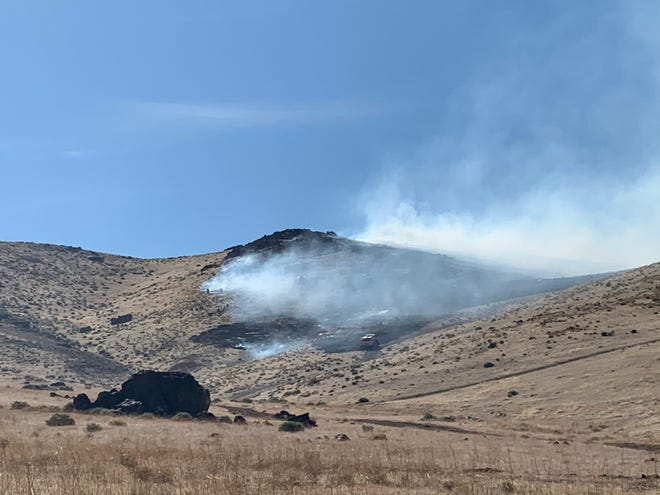Smoke is seen billowing from a brush fire burning near Pyramid Highway in Spanish Springs.