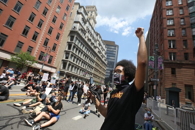 """Protesters chant """"Black Lives Matter"""" at the Black Lives Still Matter protest in downtown Rochester Friday, June 5, 2020."""