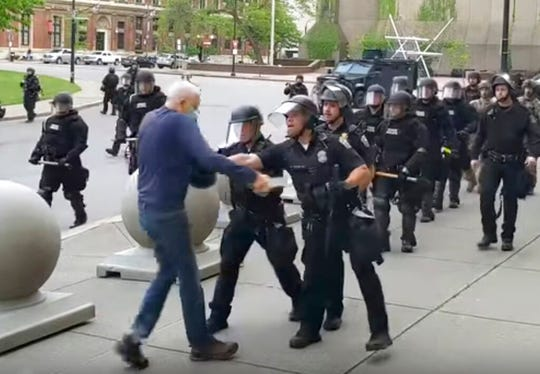 In this image from video by WBFO, a Buffalo police officer appears to shove a man who walked up to police Thursday, June 4, 2020, in Buffalo, N.Y.