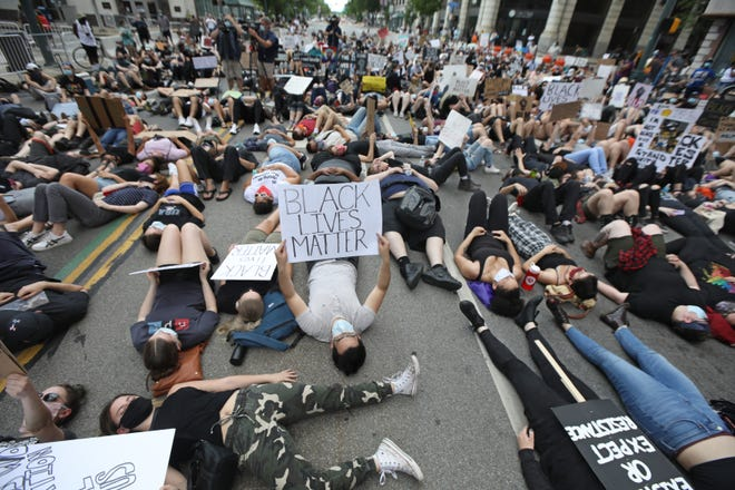 Hundreds of protesters silently lay in the street for eight minutes at the start of the Black Lives Still Matter protest in downtown Rochester Friday, June 5, 2020. The eight minutes marked the amount of time that George Floyd, a black Minnesota man, lay before dying with a police officer's knee on his neck.