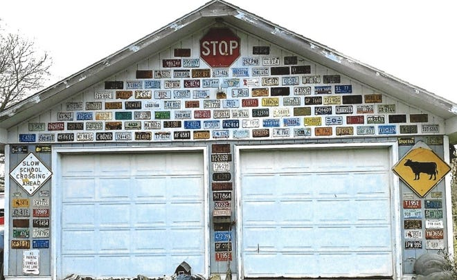 Mary Lee and Reggie Page's garage in Groveland, Livingston County, is covered with license plates.