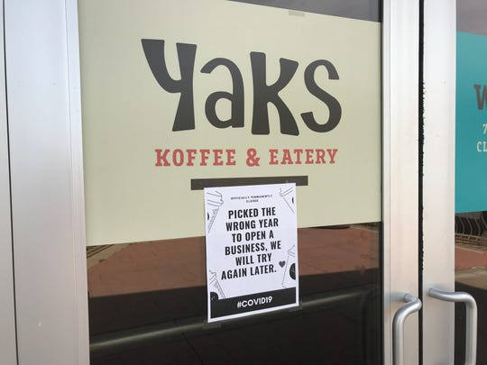 The sign on the front door of YAKS in Redding sums up the impact of the COVID-19 pandemic. The coffee shop has closed after opening in January.