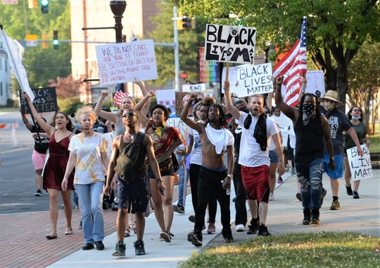 Protesters gathered in downtown Salisbury on Thursday, June 4, 2020 demanding action following the death of George Floyd who was killed in police custody in Minnesota.