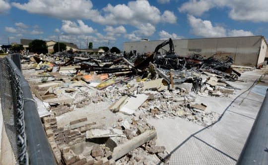 Bayou Walk shopping center is being torn down after sitting vacant for six years.