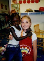 Mariyom Deng and Liz Magnuson pictured together in Jean Magnuson's preschool class.