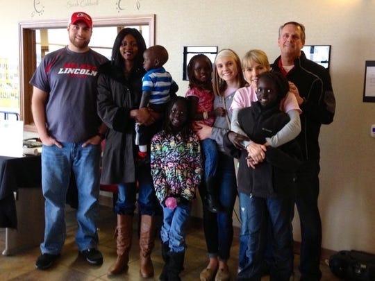 Mariyom Deng's family and Liz Magnuson's family together.