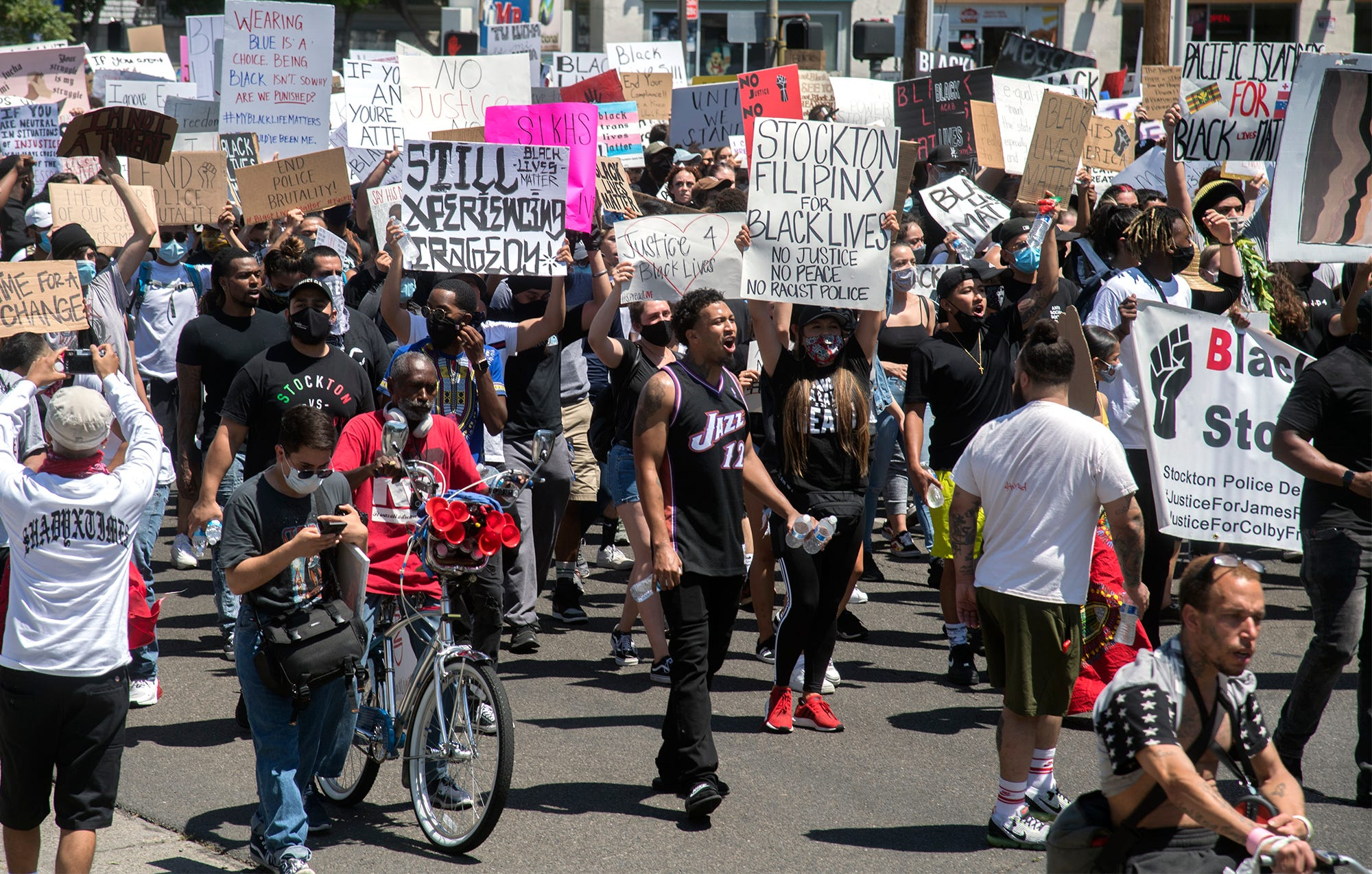 Protesters march down Center Street in downtown Stockton to protest the killing of George Floyd.