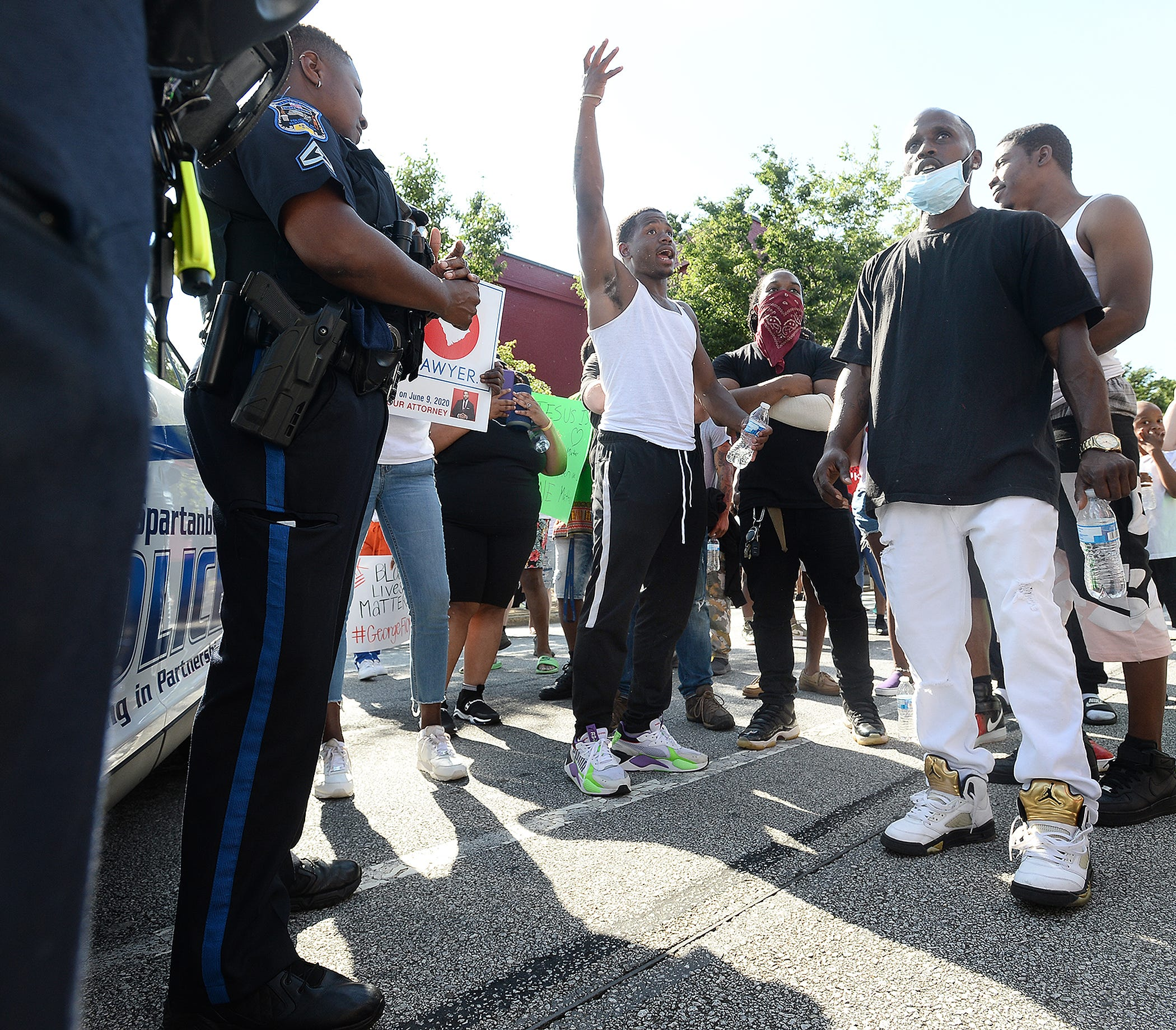 A group of peaceful protesters marched around the Spartanburg downtown area and to Barnet Park on Sunday.