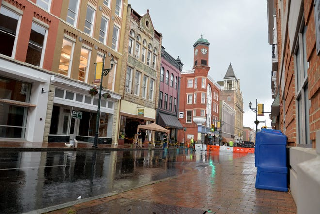 Restaurants and breweries started setting up in the rain for outdoor dining options along Beverley Street after the city closed the street the evening of June 5, 2020.