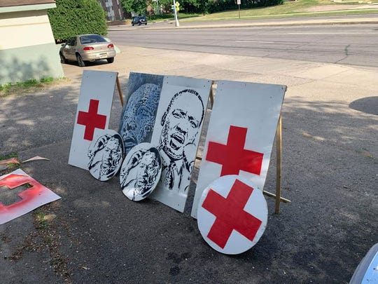 Nathan William Lewis and Adric Potter created shields and barricades to donate to medics helping protesters in Minneapolis.
