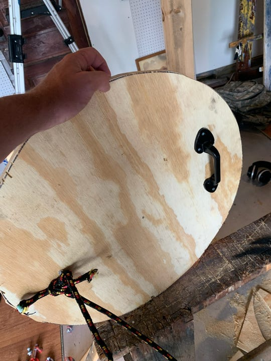 Adric Potter and Nathan Lewis created shields to donate to medics helping protesters in Minneapolis. One of the shields is pictured with a cabinet handle on the back before padding was added.