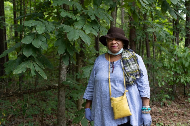 Gloria Jefferson Anderson stands in front of what she and others believe to be the location of the New Hope Cemetery, the location of unmarked graves of those who lived on the Welaunee plantation.