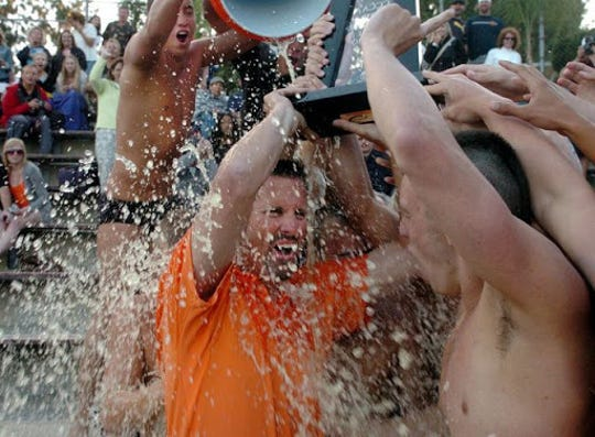Larry Baratte gets drenched after coaching the Ventura College men's swim team to the 2010 California Community College state title at Mt. San Antonio College.
