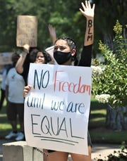 Protesters rallied at Tulare's Zumwalt Park in memory of George Floyd on Thursday, June 4, 2020.