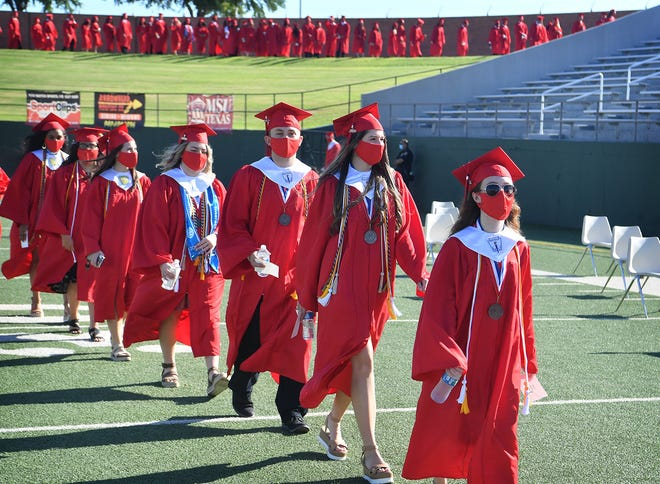 Wichita Falls High School seniors march into Memorial Stadium to begin the first WFHS outdoor graduation since 1961 which was held in Coyote Canyon, as shown in this June 5, 2020, file photo.