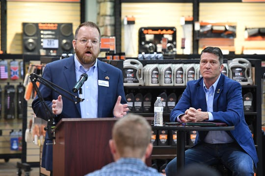 Josh Winegarner, left, and Dr. Ronny Jackson participated in a debate Thursday evening at Red River Harley-Davidson. Primary runoff elections for the 13th Congressional District are July 14.
