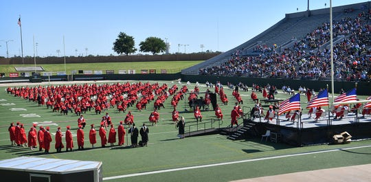 Wichita Falls High graduates and their families attended graduation ceremonies at Memorial Stadium to help comply with pandemic precautions for large gatherings in public places.