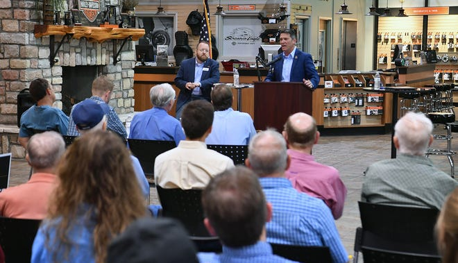 Dr. Ronny Jackson, right, answers a question during a debate with Josh Winegarner at Red River Harley-Davidson as shown in this June 4, 2020, file photo. The two Republicans are running for retiring U.S. Rep. Mac Thornberry's 13th Congressional District seat.