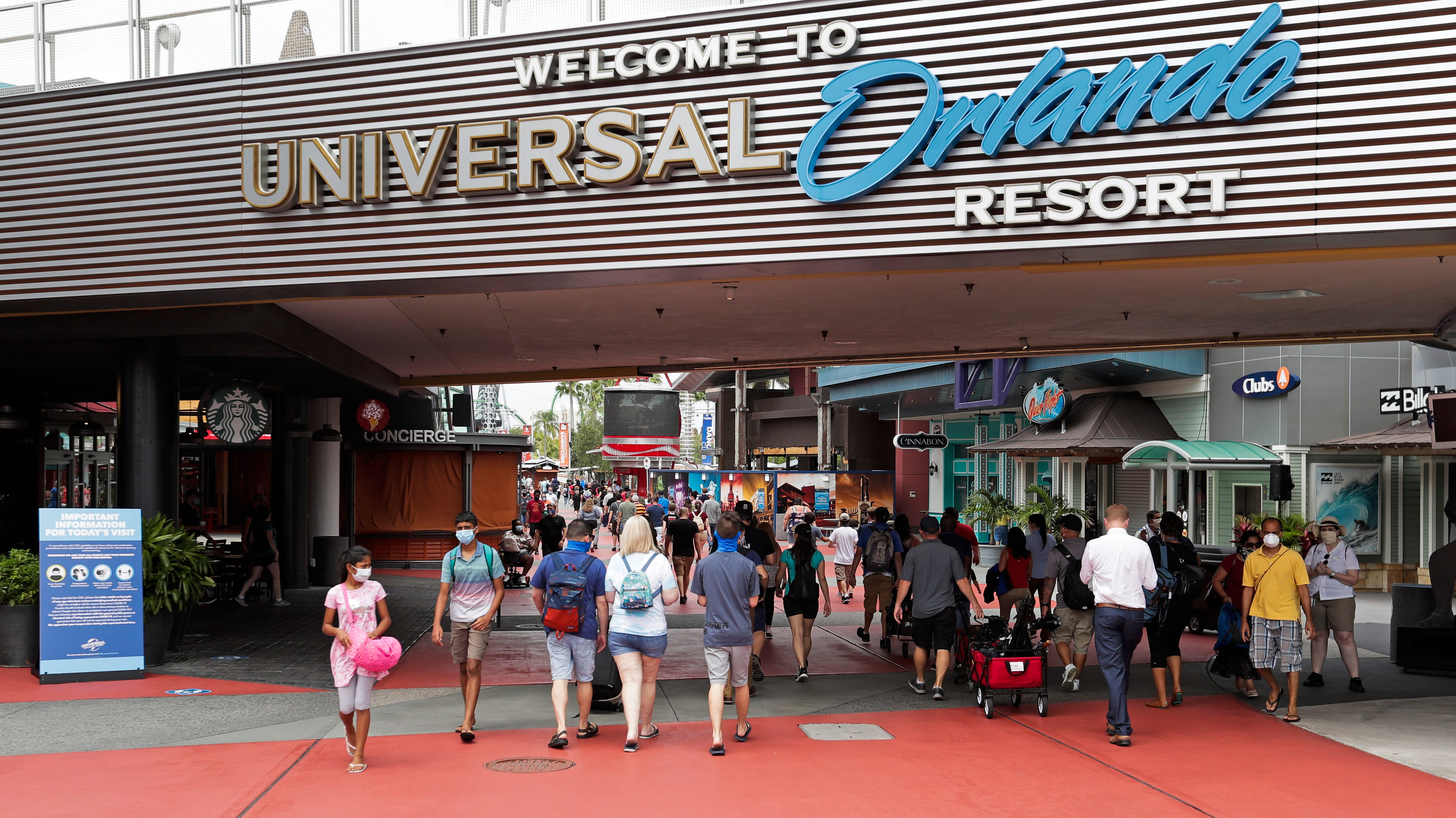 Universal Orlando, Disney World drop mask requirement outdoors, but visitors still must wear them on rides, indoors