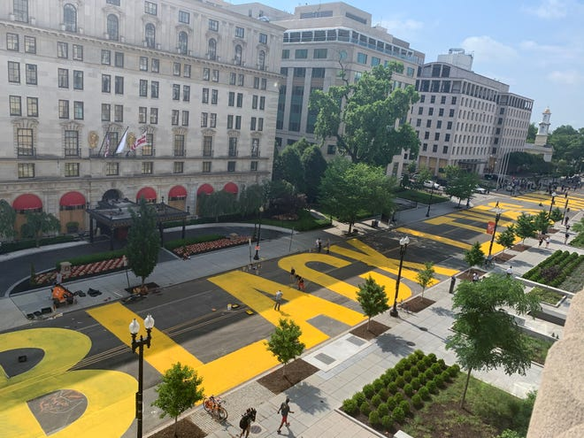 """A """"Black Lives Matter"""" mural painted on the street is seen from 16th Street in Washington DC on June 5, 2020. The mural was created as protests continue across the country to demand justice for the killing of George Floyd in Minneapolis."""
