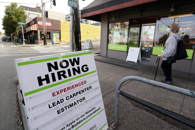 Reader board advertising a job opening for a remodeling company, in Seattle.