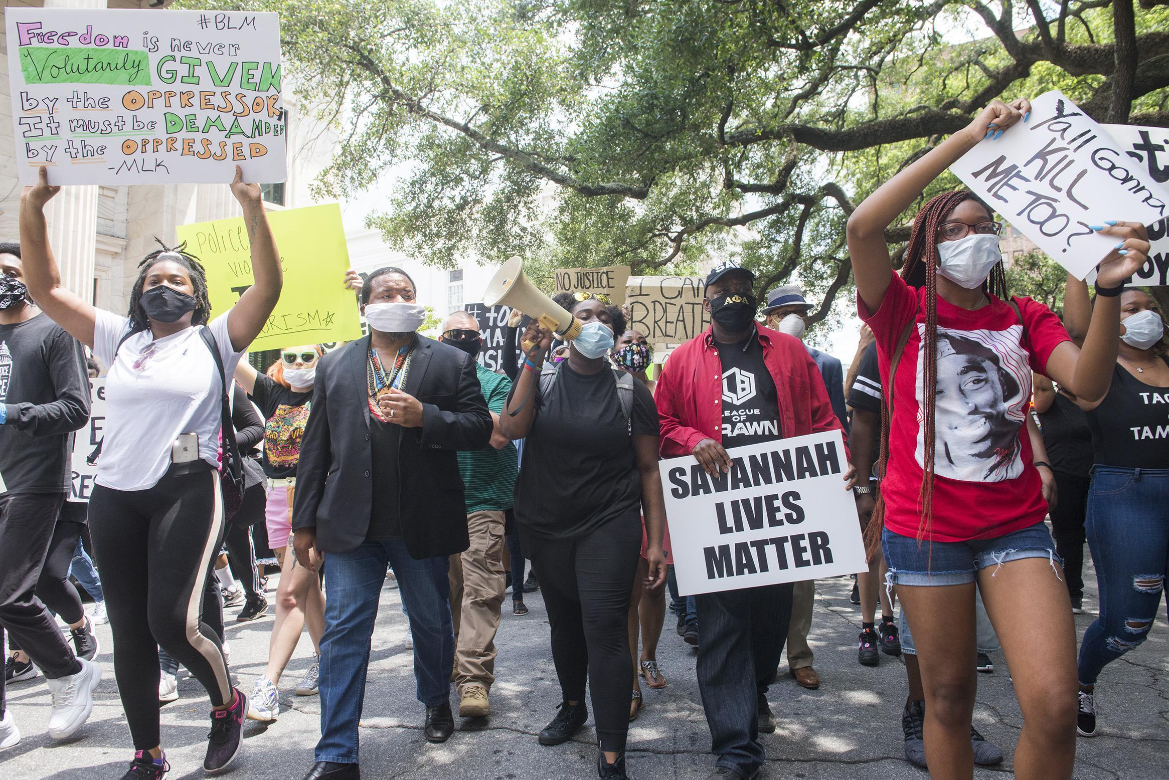 A crowd of protesters march from Johnson Square to Savannah City Hall on May 31.