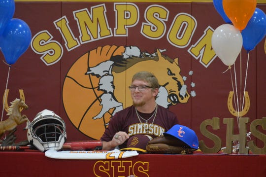 Simpson's Colton Parker smiles after signing with Louisiana College Thursday.