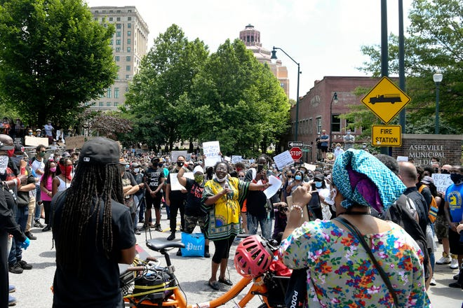 People marched again on the streets of Asheville June 6, 2020 to protest police brutality and honor the lives of those lost in the black community.