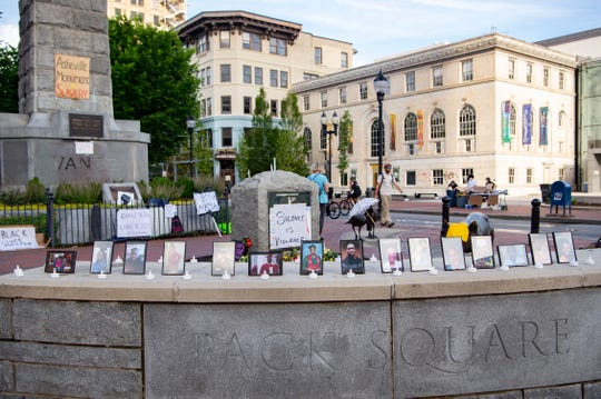 An altar with photos of victims of police brutality sits at the Vance Monument during a vigil on June 5, 2020.