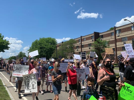 Protesters march from Corning city hall Saturday during a rally against racial injustice.