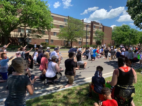 Protesters take a knee during a protest against racial injustice Saturday in Corning.