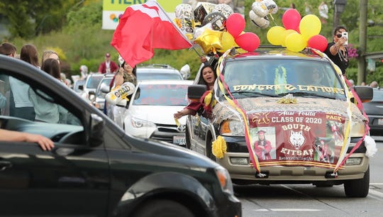 South Kitsap graduate Alisi Fosita's decorated car travels down Bay Street in Port Orchard during the Class of 2020 celebratory parade on Friday.